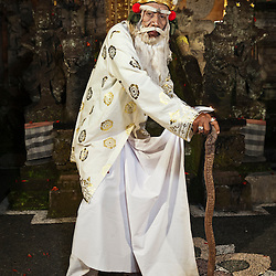 Rahwana demon in the form of an old priest character of the Taman Kaja troup  posing after a show in Pura Dalem, Ubud, Bali, Indonesia