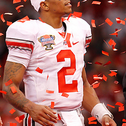 January 4, 2011; New Orleans, LA, USA;  Ohio State Buckeyes quarterback Terrelle Pryor (2) celebrates as confetti falls following a win over the Arkansas Razorbacks in the 2011 Sugar Bowl at the Louisiana Superdome.Ohio State defeated Arkansas 31-26. Mandatory Credit: Derick E. Hingle