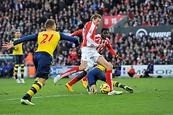 Arsenal's Hector Bellerin attempts to tackle Stoke's Peter Crouch before he scores the opening goal - Photo mandatory by-line: Dougie Allward/JMP - Mobile: 07966 386802 - 06/12/2014 - SPORT - Football - Stoke - Britannia Stadium - Stoke City v Arsenal - Barclays Premie League