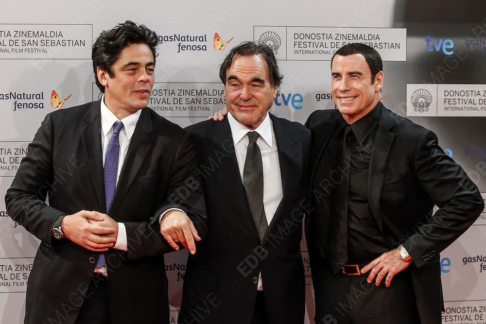 23.SEPTEMBER.2012. SAN SEBASTIAN<br /> <br /> BENICIO DEL TORO DELIVERING THE DONOSTI AWARD TO JOHN TRAVOLTA AND THE SPECIAL 60TH ANNIVERSARY DONOSTI AWARD TO OLIVER STONE AT EL KURSAAL DURING THE SAN SEBASTIAN FILM FESTIVAL IN SAN SEBASTIAN<br /> <br /> BYLINE: EDBIMAGEARCHIVE.CO.UK<br /> <br /> *THIS IMAGE IS STRICTLY FOR UK NEWSPAPERS AND MAGAZINES ONLY*<br /> *FOR WORLD WIDE SALES AND WEB USE PLEASE CONTACT EDBIMAGEARCHIVE - 0208 954 5968*