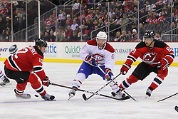 Feb 2; Newark, NJ, USA; Montreal Canadiens center David Desharnais (51) has the puck taken away by New Jersey Devils right wing Dainius Zubrus (8) and New Jersey Devils left wing Alexei Ponikarovsky (12) during the third period at the Prudential Center. The Devils defeated the Canadiens 5-3.