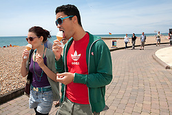 © under license to London News Pictures. 21/07/12. As temperatures rise this weekend, people enjoy ice creams on on Brighton Beach . Xavier Itter/LNP