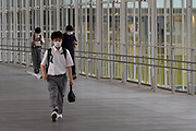 Schoolboys walking a covered walkway near Shibuya Hikarie Shibuya, Tokyo, Japan. Tuesday June 23rd 2020