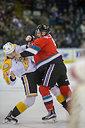 KELOWNA, CANADA - DECEMBER 03:  Konrad Belcourt #5 of the Kelowna Rockets and Blake Jameson #34 of the Brandon Wheat Kings at the Kelowna Rockets game on December 03, 2016 at Prospera Place in Kelowna, British Columbia, Canada.  (Photo By Cindy Rogers/Nyasa Photography,  *** Local Caption ***
