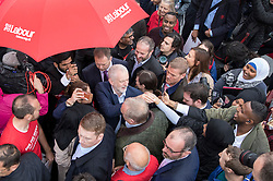 © Licensed to London News Pictures. 18/05/2017. London, UK. Labour party leader Jeremy Corbyn is surrounded by local people after he addressed a campaign rally in Southall on the same day that Prime Minister Theresa May launched the Conservative Party manifesto. Photo credit: Peter Macdiarmid/LNP