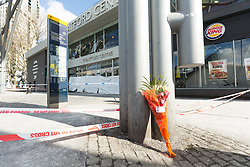 © Licensed to London News Pictures. 21/03/2018. London, UK. Flowers next to the police cordon at the scene outside the shopping centre, the Stratford Centre in east London today, where a murder investigation has been launched after a man, believed to be in his early 20's was fatally stabbed last night. Photo credit: Vickie Flores/LNP