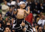A young Kings' fan smiles as he's shown on the big screen during the Kings' 4-3 victory over the Chicago Blackhawks during Game 3 of the Western Conference Final of the 2014 NHL Stanley Cup Playoffs at Staples Center Saturday.