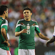 Oribe Peralta, Mexico, in action during the Portugal V Mexico International Friendly match in preparation for the 2014 FIFA World Cup in Brazil. Gillette Stadium, Boston (Foxborough), Massachusetts, USA. 6th June 2014. Photo Tim Clayton
