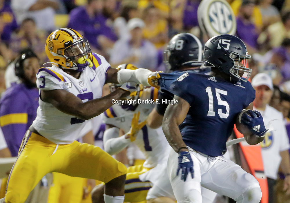 Aug 31, 2019; Baton Rouge, LA, USA; LSU Tigers safety JaCoby Stevens (3) tackles Georgia Southern Eagles running back J.D. King (15) during the first quarter at Tiger Stadium. Mandatory Credit: Derick E. Hingle-USA TODAY Sports