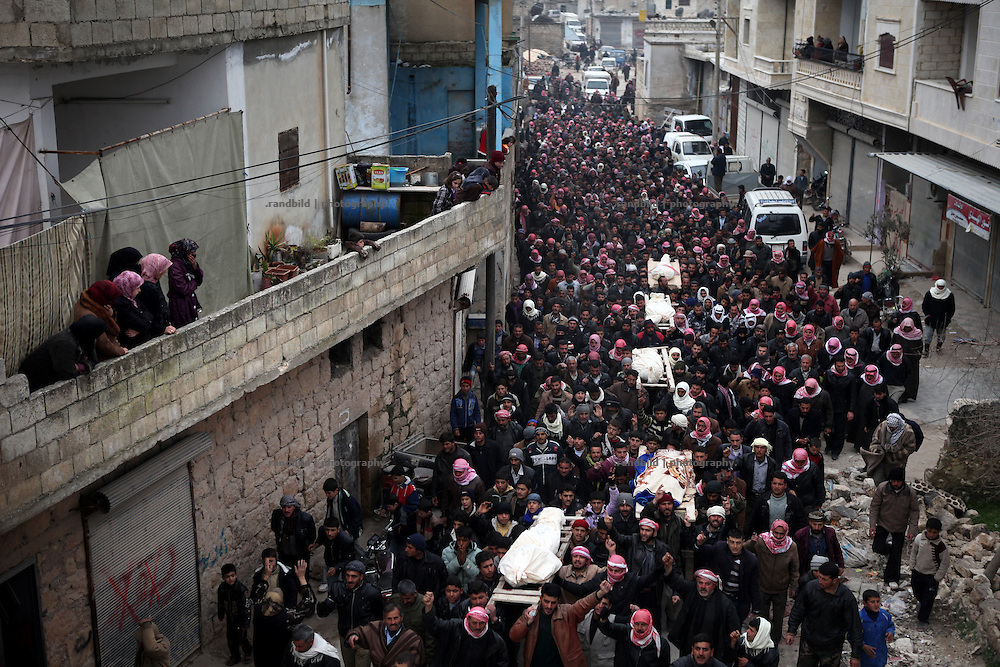 About two thousand inhabitants of Kureen, Province of Idlib, Syria, gather for the funeral of four men and one woman killed yesterday during a full scale military attack on the village.