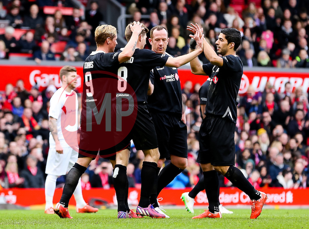 Steven Gerrard celebrates after scoring his second penalty of the game - Photo mandatory by-line: Dougie Allward/JMP - Mobile: 07966 386802 - 29/03/2015 - SPORT - Football - Liverpool - Anfield Stadium - Gerrard's Squad v Carragher's Squad - Liverpool FC All stars Game