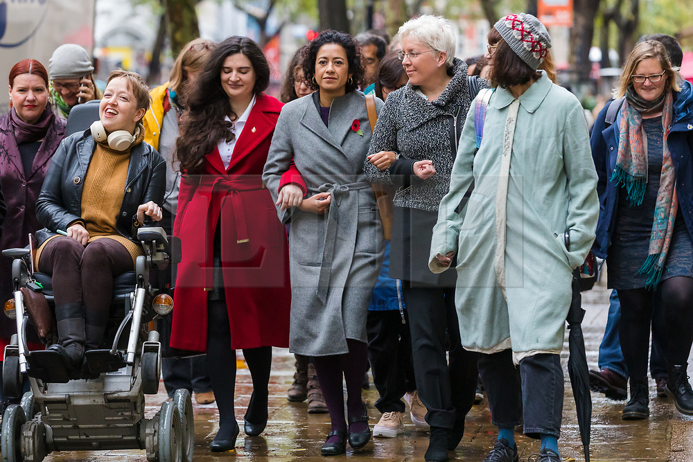 © Licensed to London News Pictures. 01/11/2019. London, UK. Television presenter, Samira Ahmed (C) with her supporters, including BBC journalist Carrie Gracie (3R), arrives at the Central London Employment Tribunal to attend an equal pay case hearing against the BBC. Samira Ahmed, who presents Newswatch on BBC One and Radio 4's Front Row claims she was paid less than male colleagues for doing equivalent work under the Equal Pay Act. Photo credit: Vickie Flores/LNP
