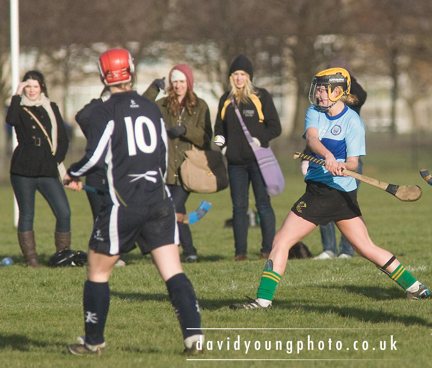 British Universities Camogie (Women's Hurling) in light blue team take on Scottish Universities Shinty team in an amalgam of the the two sports.- © David Young - .5 Foundry Place - .Monifieth - .Angus - .DD5 4BB - .Tel: 07765 252616 - .email: davidyoungphoto@gmail.com.web: www.davidyoungphoto.co.uk