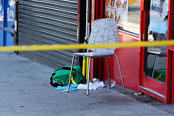 © Licensed to London News Pictures. 14/09/2019. London, UK. A medical kit within the crime scene on Downham Way in Lewisham as a murder investigation has been launched by Met Police after a 34 years old man died in hospital. The victim suffered stab and head wounds on Friday 13 Sept following a fight inside Metro chicken shop on Downham way. A 51 year old man was also injured in the fight and has since been discharged from hospital and subsequently arrested in suspicion murder. Two other men aged 40 and 46 have also been arrested on suspicion murder. Photo credit: Dinendra Haria/LNP
