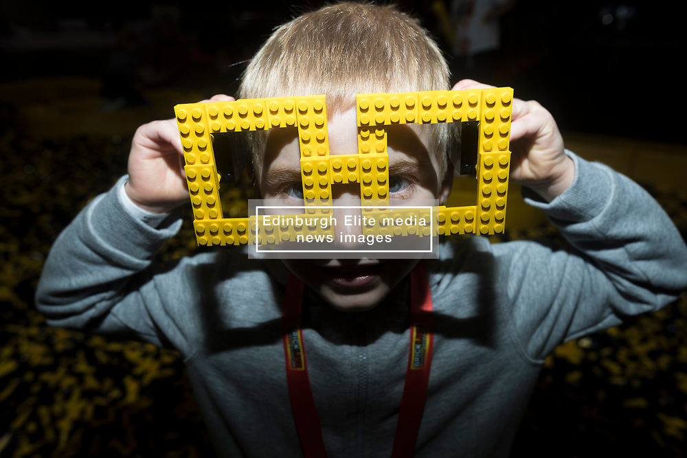The SEC in Glasgow hosts Brick Live, the largest LEGO exhibition in the UK. Featuring models made up of over 6 million bricks, LEGO enthusiasts can build their own creations as well as admiring the models created by some of the leading designers including Scotland's Nick Clayton and Rocco Buttliere from Chicago.<br /> <br /> Pictured: 4 year old Lewis Hughes with a pair of glasses made from Lego bricks