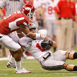 January 4, 2011; New Orleans, LA, USA;  Ohio State Buckeyes running back Dan Herron (1) is tackled by Arkansas Razorbacks safety Tramain Thomas (5)during the fourth quarter of the 2011 Sugar Bowl at the Louisiana Superdome.Ohio State defeated Arkansas 31-26. Mandatory Credit: Derick E. Hingle