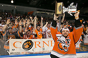 RIT forward Andrew Miller celebrates after RIT defeated Robert Morris University to win the Atlantic Hockey final at the Blue Cross Arena in Rochester on Saturday, March 19, 2016.