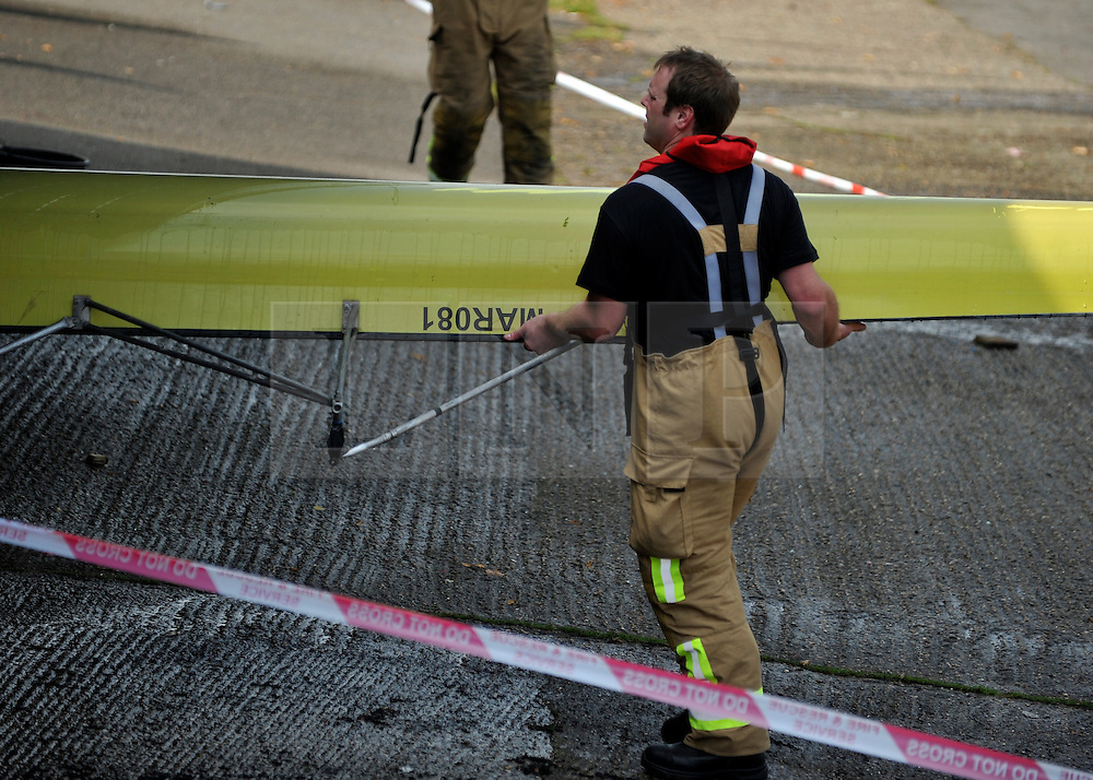 © licensed to London News Pictures. MARLOW, UK.  03/08/11. A fireman moves a boat. Marlow Rowing Club has been badly damaged by fire today (03 August 2011). Boats with an estimated value of 100,000 pounds have been damaged. Steve Redgrave, Olympic Rower, who trained at the club and is from Marlow said his daughters boat is believed to be inside.  Mandatory Credit Stephen Simpson/LNP