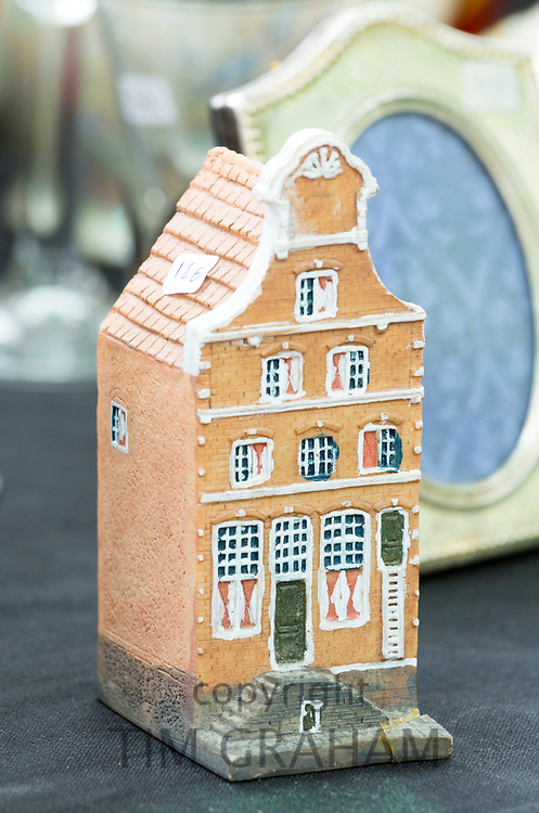 Traditional ceramic Belgian house antiques and bric a brac objects at street stall at market in Bruges, Belgium