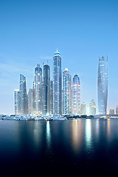 Modern skyline at night of high rise skyscrapers in Marina district of Dubai United Arab Emirates