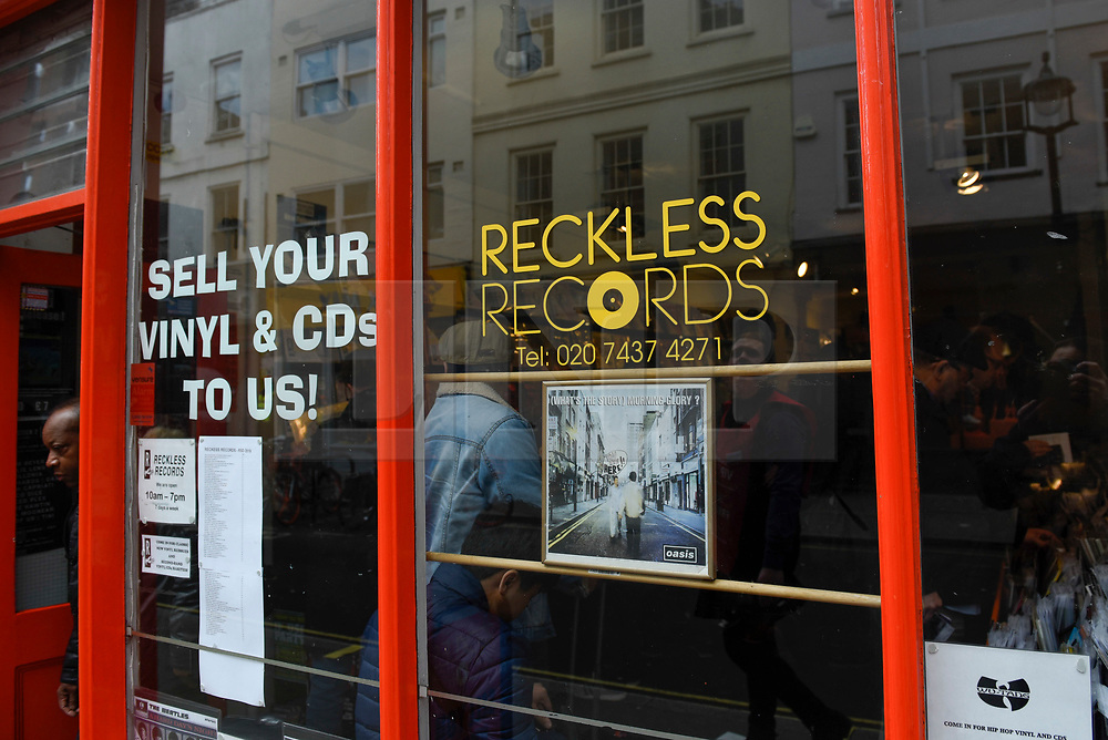 © Licensed to London News Pictures. 13/04/2019. LONDON, UK. Reckless Records exterior. Analogue music fans visit independent record shops in Soho to celebrate vinyl music on the 12th Record Store Day.  Over 200 independent record shops across the UK come together annually to celebrate the unique culture of analogue music with special vinyl releases made exclusively for the day.  In 2018, sales of vinyl rose for the 11th consecutive year to 4.2 million units according to the British Phonographic Industry (BPI).  Photo credit: Stephen Chung/LNP