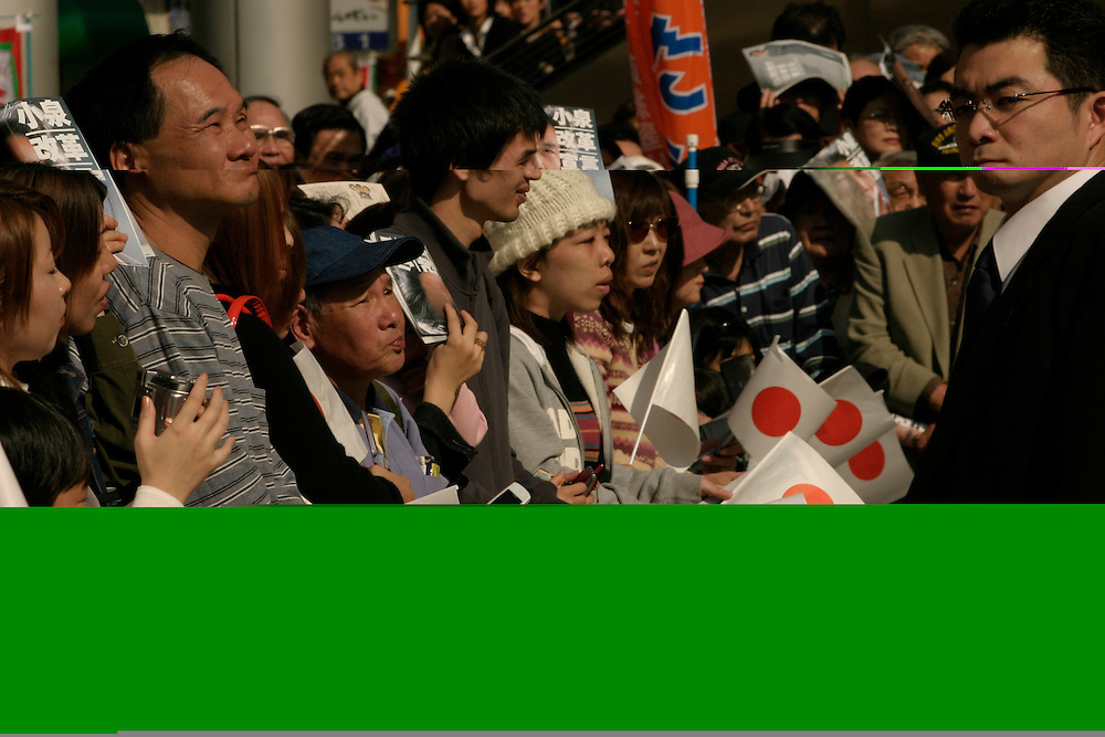Japanese Prime Minister Junichiro Koizumi  campaigns for LDP candidates for the upcoming House of Representatives election november 9th 2003 also shots of  supporters at a rallies in suburban tokyo