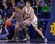 SOUTH BEND, IN - JANUARY 12: Wynston Tabbs #5 of the Boston College Eagles dribbles the ball against Nate Laszewski #14 of the Notre Dame Fighting Irish at Purcell Pavilion on January 12, 2019 in South Bend, Indiana. (Photo by Michael Hickey/Getty Images) *** Local Caption *** Wynston Tabbs; Nate Laszewski