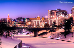 Brush Creek frozen over in the winter with the Plaza Lights<br />