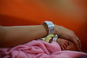 Wrist band on mother and new born baby immidiatly after birth