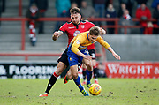 Morecambe's Max Müller(22) fouls Mansfield Town's Danny Rose(32) during the EFL Sky Bet League 2 match between Morecambe and Mansfield Town at the Globe Arena, Morecambe, England on 27 January 2018. Photo by Paul Thompson.