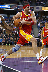 March 7, 2011; Sacramento, CA, USA;  Houston Rockets center Brad Miller (52) dribbles in the lane against the Sacramento Kings during the second quarter at the Power Balance Pavilion.