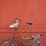 Super-tall bicycle on 4th Avenue sidewalk, Tucson, Arizona. Bike-tography by Martha Retallick.