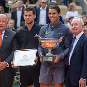 PARIS, FRANCE June 09.  Bernard Giudicelli, President of the French Tennis Federation, Dominic Thiem of Austria with the runners up trophy, Rafael Nadal of Spain with the winners trophy and Australian tennis legend Rod Laver who presented the trophies on Court Philippe-Chatrier after the Men's Singles Final at the 2019 French Open Tennis Tournament at Roland Garros on June 9th 2019 in Paris, France. (Photo by Tim Clayton/Corbis via Getty Images)