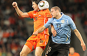 CAPE TOWN, SOUTH AFRICA- Tuesday 6 July 2010, Mark van Bommel and Diego Perez chalenge for the ball during the semi final match between Uruguay and the Netherlands (Holland) held at the Cape Town Stadium in Green Point during the 2010 FIFA World Cup..Photo by Roger Sedres/Image SA
