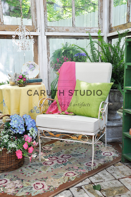 Vintage garden: Seating nook inside glass shed