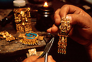 MEXICO, CRAFTS craftsman making reproductions of famous prehispanic 'Mixtec' gold jewelry in Oaxaca