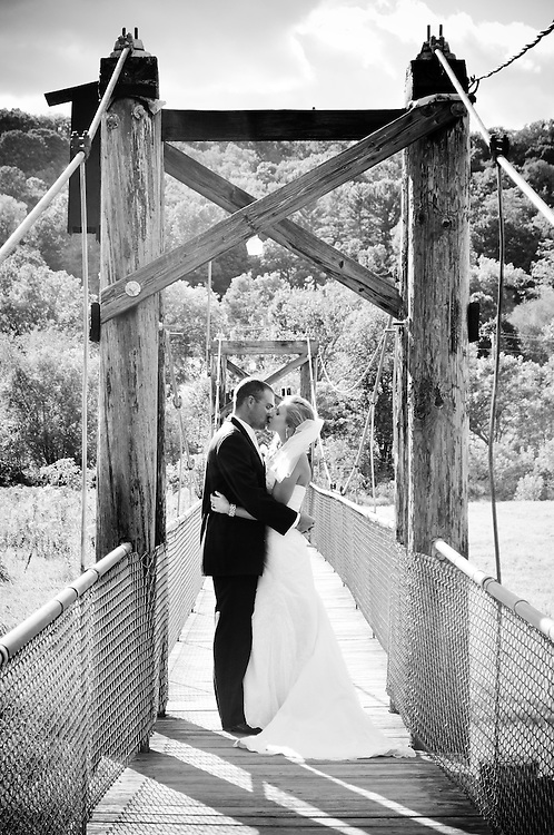 Abby & Matt kiss on a foot bridge, Richland Center, WI