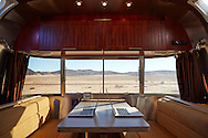 A mobile office inside of an Airstream parked in the Mojave Desert of California.