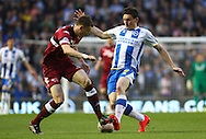 Keith Andrews of Brighton and Hove Albion (right) and Craig Forsyth of Derby County (left) during the Sky Bet Championship play off semi final first leg at the American Express Community Stadium, Brighton and Hove<br /> Picture by David Horn/Focus Images Ltd +44 7545 970036<br /> 08/05/2014