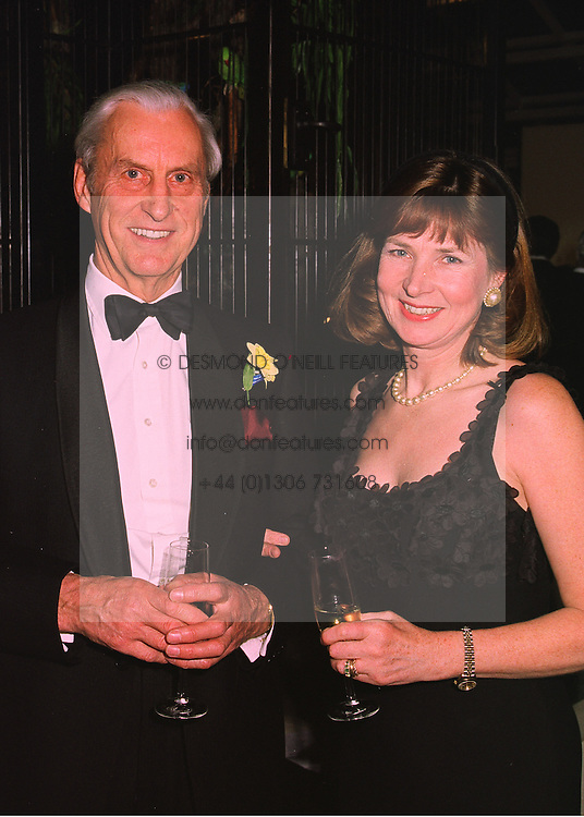 MAJOR GENERAL SIR MICHAEL & LADY CARLETON-SMITH at a party in London on 23rd March 1998.MGH 55