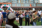 Attendees pick out their next dish during the 4th annual Yum Yum Fest held at Breese Stevens Field, Sunday, August 6, 2017.