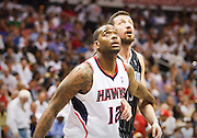 24 April 2011: Atlanta's Josh Powell (12) is blocking out Orlando's Hedo Turkoglu in Atlanta Hawks 88-85 victory over the Orlando Magic in Eastern Conference First Round Game 4 at Philips Arena in Atlanta, GA.