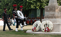 © Licensed to London News Pictures. 11/11/2012. Delhi, India. Soldiers of the Indian Army carry a wreath to a memorial at a Remembrance Day ceremony held at the Delhi War Cemetery, India. Remembrance Day (also known as Poppy Day or Armistice Day) is a memorial day observed in Commonwealth countries since the end of World War I to remember the members of their armed forces who have died in the line of duty. This day, or alternative dates, are also recognized as special days for war remembrances in many non-Commonwealth countries. Remembrance Day is observed on 11 November to recall the end of hostilities of World War I on that date in 1918.   Photo credit : Richard Isaac/LNP