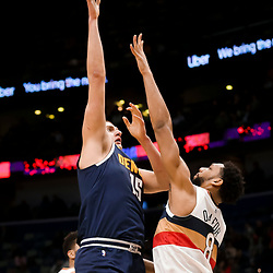 Jan 30, 2019; New Orleans, LA, USA; Denver Nuggets center Nikola Jokic (15) shoots over New Orleans Pelicans center Jahlil Okafor (8) during the second quarter at the Smoothie King Center. Mandatory Credit: Derick E. Hingle-USA TODAY Sports