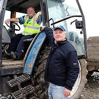 Stuarts Christy Kelly and Eugene Costello get the track ready at the strand races in Kilkee on Sunday.<br />