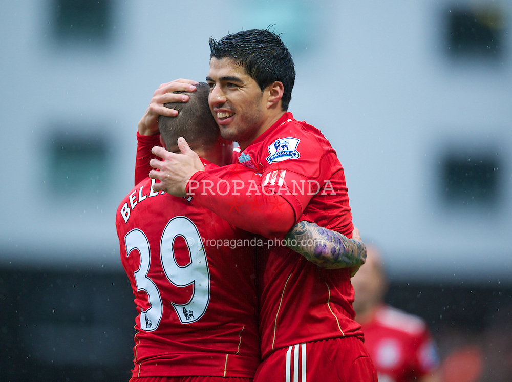 NORWICH, ENGLAND - Saturday, April 28, 2012: Liverpool's Luis Alberto Suarez Diaz celebrates scoring the first goal of his hat-trick against Norwich City with Craig Bellamy during the Premiership match at Carrow Road. (Pic by David Rawcliffe/Propaganda)