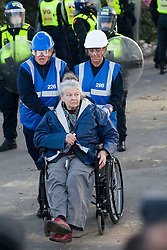 © Licensed to London News Pictures. 19/10/2011. Crays Hill, UK. A demonstrator in a wheelchair is removed from the front gate by demonstrators. Residents at Dale Farm, the UK's largest illegal traveller site being evicted today (19/10/2011) following a long dispute with Basildon Council . Travellers and activist had barricaded themselves in to the site in an attempt to prevent their eviction. Photo credit: Ben Cawthra/LNP