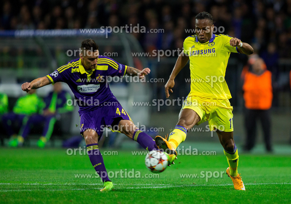 Soares Bordignon Arghus of Maribor vs Didier Drogba of Chelsea during football match between NK Maribor, SLO  and Chelsea FC, ENG in Group G of Group Stage of UEFA Champions League 2014/15, on November 5, 2014 in Stadium Ljudski vrt, Maribor, Slovenia. Photo by Vid Ponikvar / Sportida