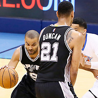 06 May 2016:  San Antonio Spurs guard Tony Parker (9) drives past Oklahoma City Thunder guard Andre Roberson (21) on a screen set by San Antonio Spurs center Tim Duncan (21) during the San Antonio Spurs 100-96 victory over the Oklahoma City Thunder, during Game Three of the Western Conference Semifinals of the NBA Playoffs at the Chesapeake Energy Arena, Oklahoma City, Oklahoma, USA.