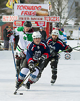 Two local teams Puck Nuts and ReiMax Hackers battle it out on the ice in the Twig division during play Friday in the New England Pond Hockey Classic.  (Karen Bobotas/for the Laconia Daily Sun)